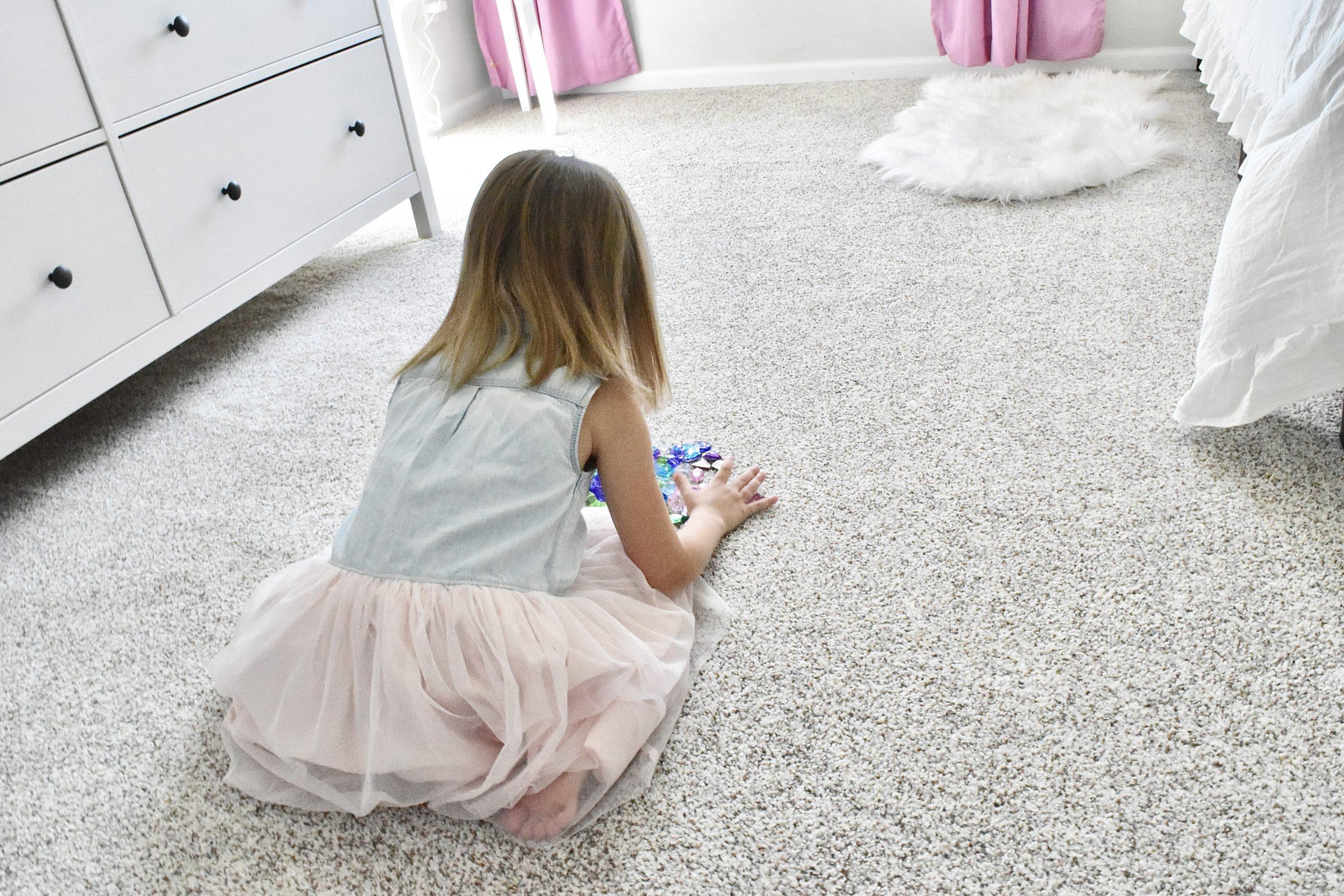 Toddler Girl Playing on Carpet